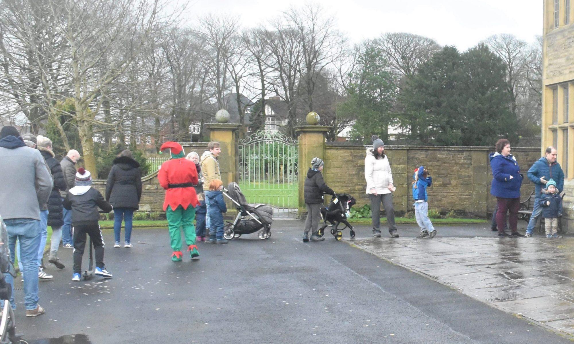 Elf Liz and visitors to see Santa